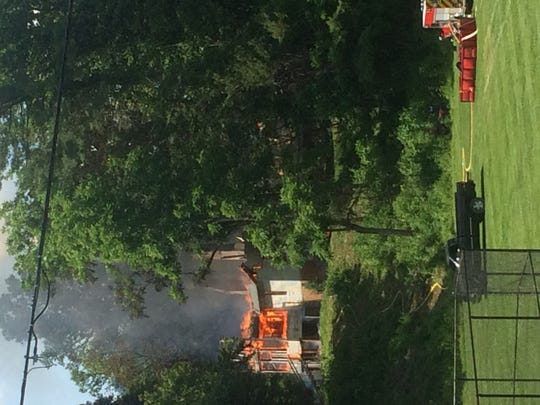 Flames rising from the Hickory Road home could be seen from the Mars Hill University tennis courts after 3 p.m. June 10.