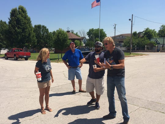 Shelby Janes, Todd Bassore, Luis Peraza and Corbin Timbrook scout locations in downtown Marionville on June 10, 2017 for a feature movie to be shot there during summer 2017. Bassore's father wrote the book on which the movie is based; the other three work in the Los Angeles film industry.