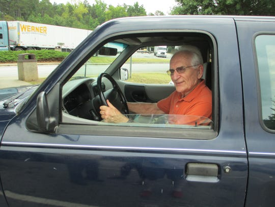 Curt Thomas in his truck.