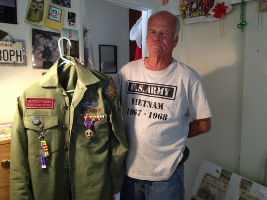 The Purple Heart and other medals Vietnam War veteran Eddie Johnson of Desert Hot Springs was awarded during his service in the U.S. Army are pinned to his fatigues shirt.