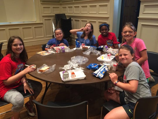 Kids eat lunch at the 37th Annual Kid Music Day Camp