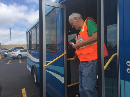 Wheels To Work volunteer Jon Harber disembarks with