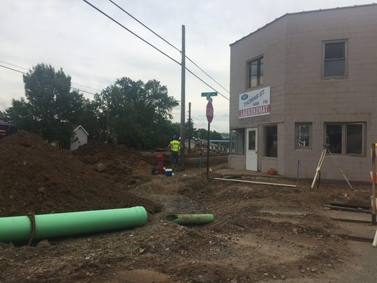 The road in front of the Thomas Street Laundromat at 421 W Thomas St. has been torn up, bringing down the number of customers considerably.
