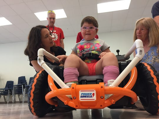Miley Brochu is ready to race  - almost. The team is refitting the seat before she can take another ride at Champlain Valley Union High School in Hinesburg on Monday, June 12, 2017.