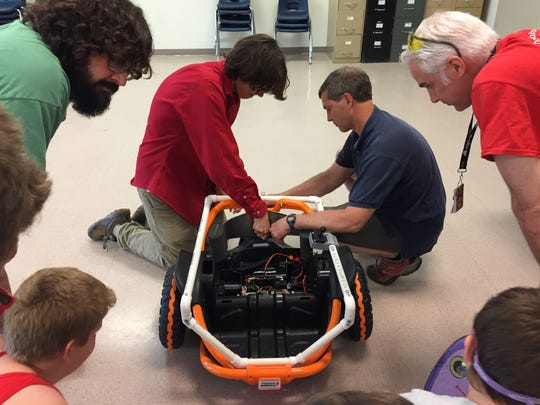 Solutions are a group activity at the Champlain Valley Union robotics lab on Monday, June 12, 2017.