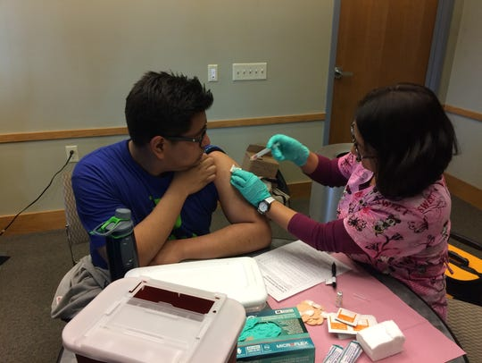 A teenager is vaccinated at an Immunize Nevada community