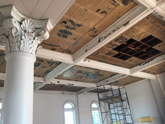 Construction workers removed ceiling covering the original