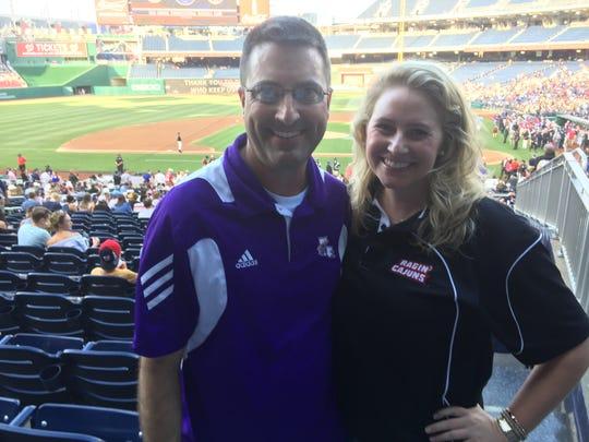 "Treg Ancelet, a native of Houma, and Elisse LaBarre, sport Louisiana shirts Thursday at the Congressional Baseball Game. ""Louisiana has great pride,'' Ancelet said."