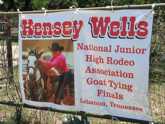 The banner announcing Kensey Wells' qualification to