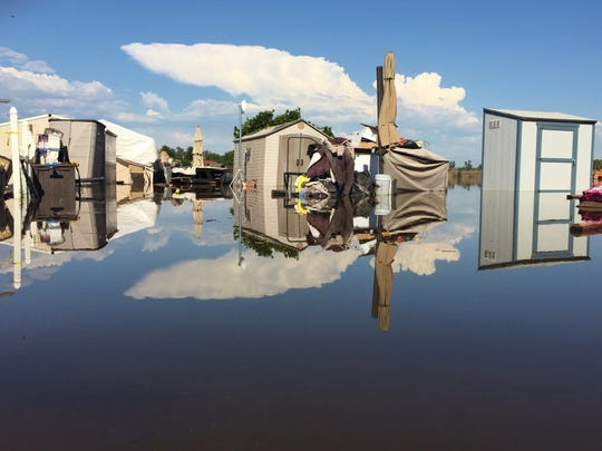 The Kings River overflowed and flooded homes at Riverland