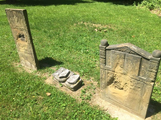 Some headstones in the Philipps Cemetery are missing; others lay flat and are being further exposed to erosion.