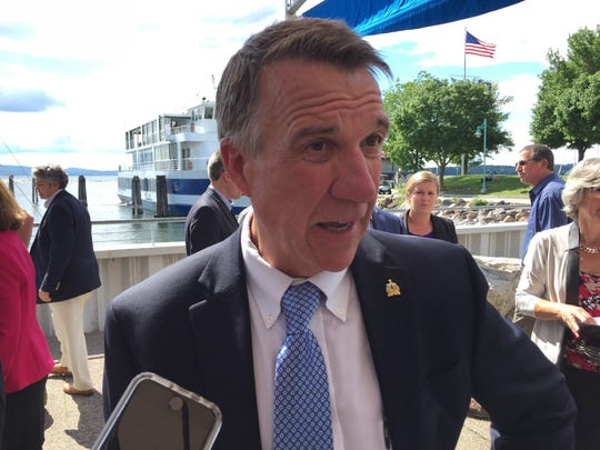 Gov. Phil Scott speaks to reporters about state budget negotiations after a Burlington news conference on Tuesday, June 20, 2017.