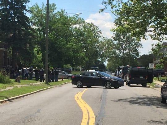 Law enforcement officials gather outside a Detroit