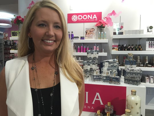 Keri Birchby, a buyer for Fascinations, selects the