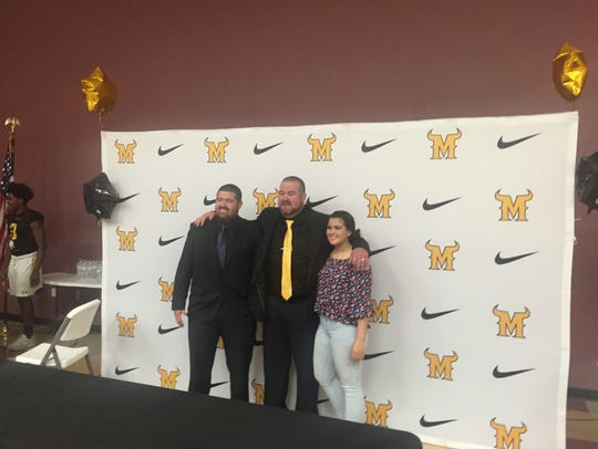Eric Frontz, center, is the new head football coach