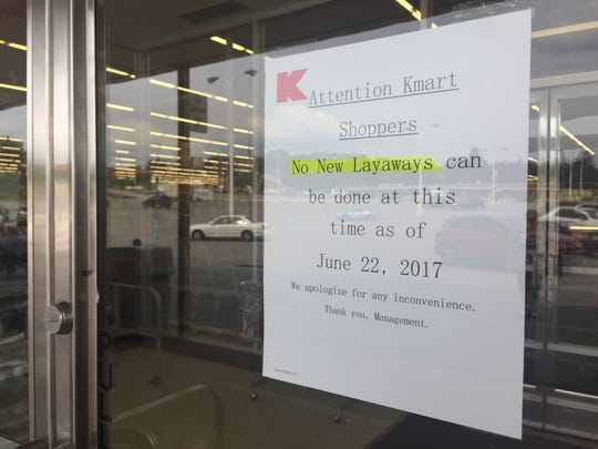 A sign visible from outside Kmart states that the store will no longer accept layaway sales.