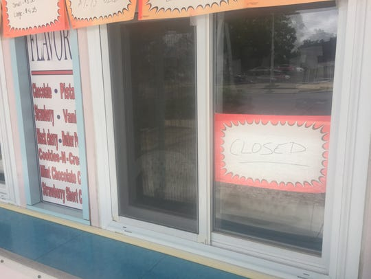 A 'closed' sign is in the window at Vineland's Cool