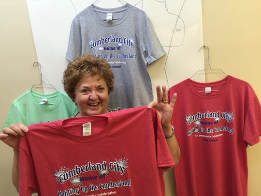 Cheryl Milliken displays the 2017 official T-shirt