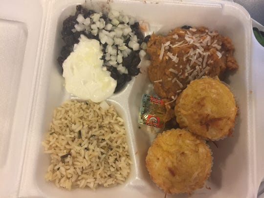 Calypso Cafe's beans and three — Cuban black beans and a choice of three side items. Here, St. Lucian rice, Boija muffins and spiced sweet potatoes are pictured.
