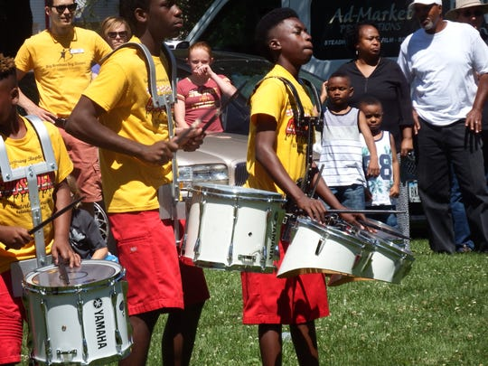 A  crowd watches the Union Missionary Baptists Church Crusaders drumeline and drill team perform as part of Iowa City's Juneteenth celebration at Mercer Park on June 24, 2017.