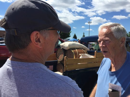 Tim Toepel, left, of St. Clair talks with Roger Schaller about Toepel's 1931 Ford Model A pickup.