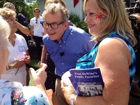 Republican Attorney General Mike DeWine greets supporters at his home in Cedarville, Ohio, on Sunday after announcing he is running for governor. (AP Photo/Julie Carr Smyth)
