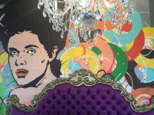 A mural from Des Moines artist Van Holmgren decorates