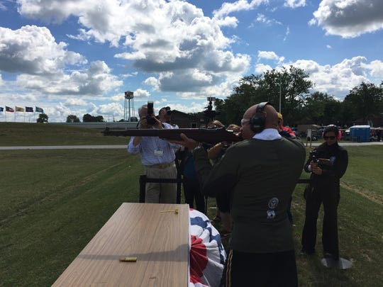 Major General John C. Harris, Jr., takes the first shot to open the season for the Civilian Marksmanship Program at Camp Perry.