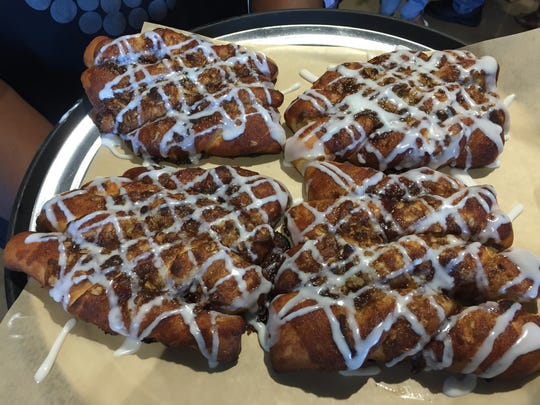 Donatos Pizza's pull-apart cinnamon bread is topped with cinnamon-sugar streusel and drizzled with vanilla icing.