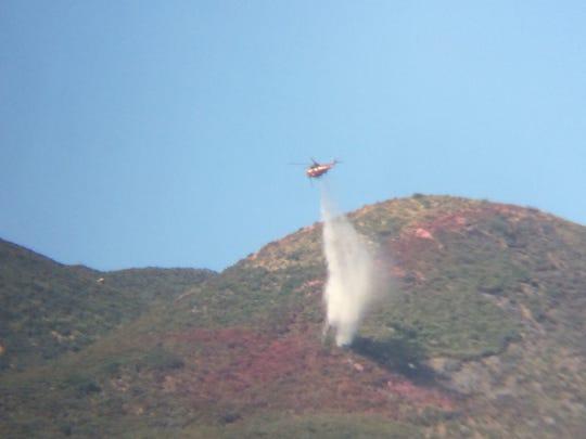 Aircraft dousing hotspots in the Manzanita Fire zone