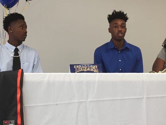 Rugde Hyppolite, left, and Hollis Hardwick at their signing ceremony Wednesday at the Village School. Both players signed to play basketball at North Iowa Area Community College.