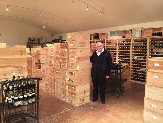 Century founder Sherwood Deutsch poses with some of his finest wines.
