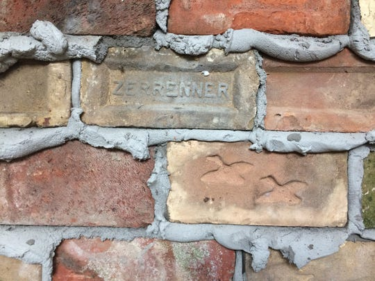 Names and designs are imprinted in bricks.