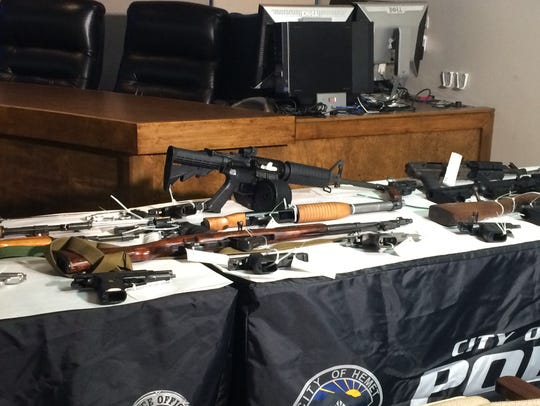 Over 30 weapons were seized in Thursday's raids.