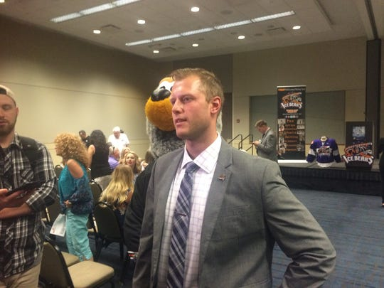 Flanked by the team's mascot, Jeff Carr spoke with the media Thursday after being introduced as the Knoxville Ice Bears' new coach.
