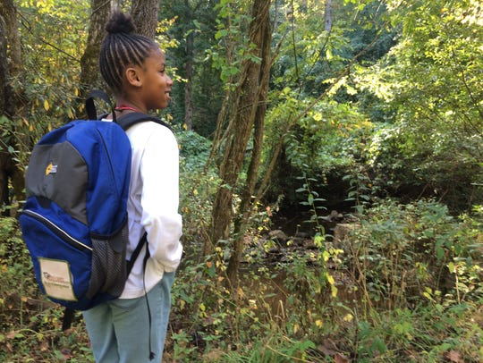 Kimorrah Barton-Ray takes part in a Muddy Sneakers educational program in Bent Creek Experimental Forest in Asheville.