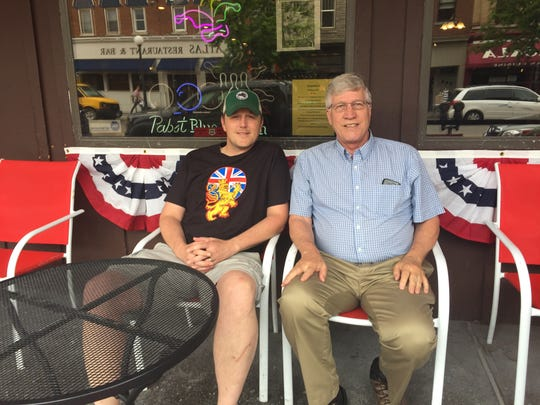 New Deadwood Tavern owner Ben Mummey, left, sits with