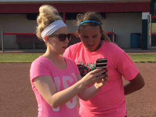 Shana (Szypka) Scharer, left, and Oak Harbor pitcher