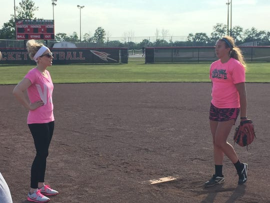Oak Harbor pitcher Ashley Riley, right, looks up to