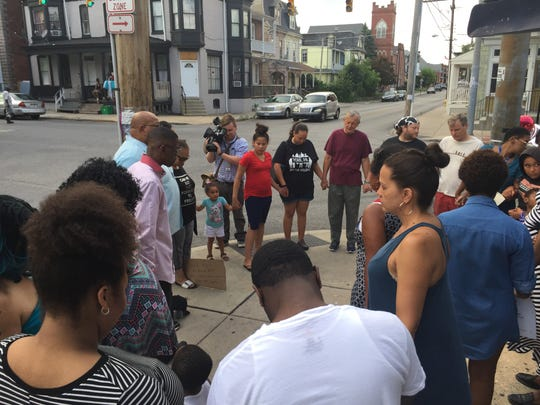 In this file photo from July 3, 2017, people pray for peace during a vigil at the corner of West Princess Street and South Belvidere Avenue in York. Elizabeth Vega-Tirado, 48, of York, was shot and killed while leaving a corner store in the area.