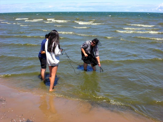 Local high school students monitoring water quality last summer in Lake Ontario