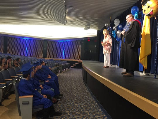 CHS principal Mark Driskell and acting superintendent Kelli Barta speak to the graduates at the summer commencement, June 30, 2017.
