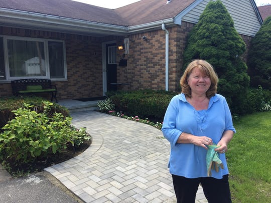 Sloatsburg resident Patti Ursel standing in front of her home on Liberty Rock Road, which was recently connected to the new sewer system.