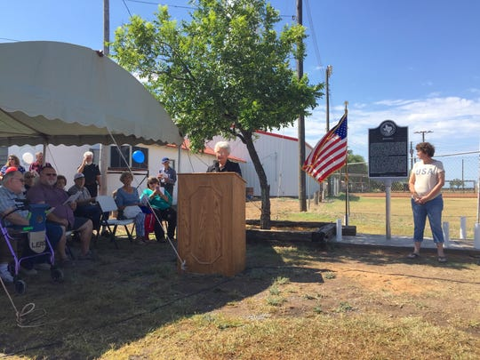 Ruth Cooper welcomes attendees to Rowena's Official Texas Historical Marker dedication on July 1, 2017.