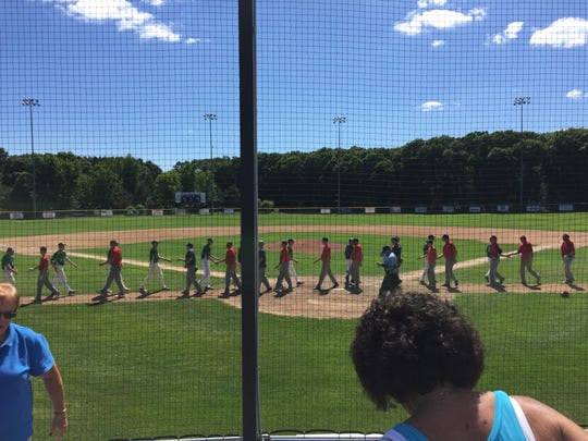 The Sartell Muskies and Clear Lake Lakers shake hands after Sunday's game at Champion Field. Sartell won, 9-3.