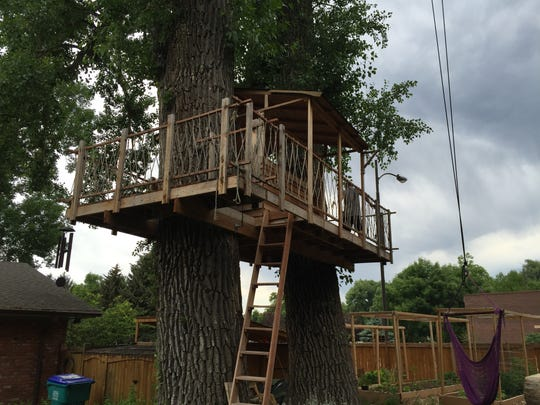 Located in University Acres, this treehouse features wrap-around decking and intricate rope details.