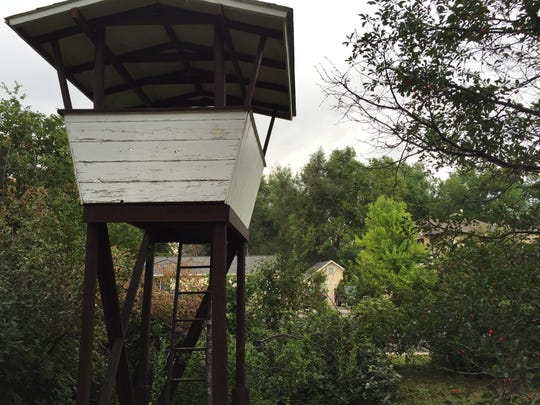 """This tidy little treehouse was once located next door near City Park. It's first owners, a teenage brother and sister, saw to a tunnel and """"basement"""" being built under its original tree."""