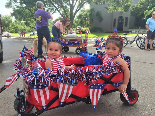 Jessie Gamez is all smiles alongside sister Reagan Gamez on Tuesday during the 23rd annual July 4th Neighborhood Parade near Santa Rita Park.