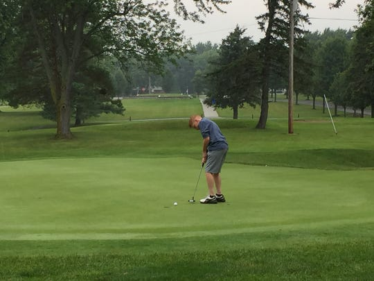Logan Keller drops in a putt on the ninth hole at Veterans Memorial Park Golf Course in Kenton Thursday afternoon during a Heart of Ohio Junior Golf Association event.