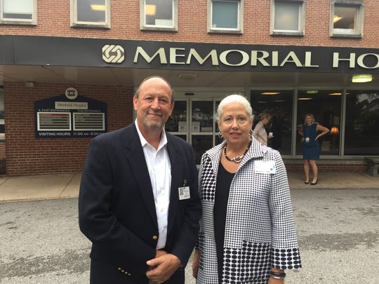 Philip Guarneschelli, left, CEO of PinnacleHealth, and Sally Dixon, right, CEO of Memorial Hospital, took part in a ceremony at Memorial in July to celebrate the hospital becoming part of PinnacleHealth.